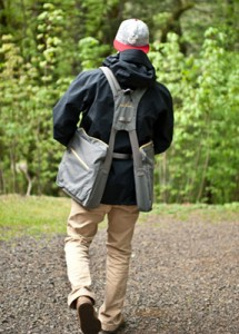 Back View of young man wearing BackTpack, the balanced bag for scoliosis