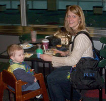 Mom using here BackTpack while traveling with children