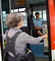 Commuter Boarding a Bus with BackTpack