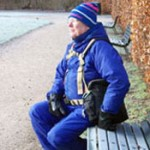 Man in Denmark resting comfortably on a bench wearing his BackTpack