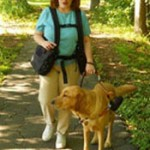 Woman with guide dog in comfort and balance using her BackTpack