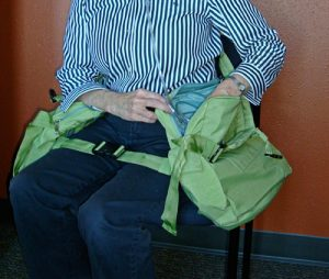 oxygen tank user seated using the LAP-STRAP