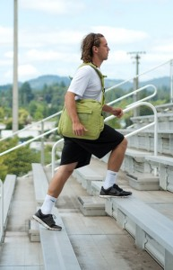 Athlete Climbing Stairs with BackTpack, a Posture Training Bag