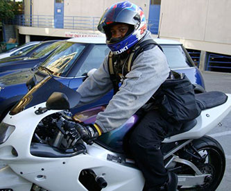 Motorcyclist Using BackTpack