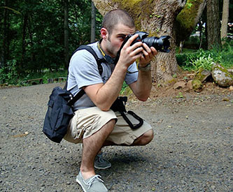 Photographer Using BackTpack, an ergonomic photography/field bag
