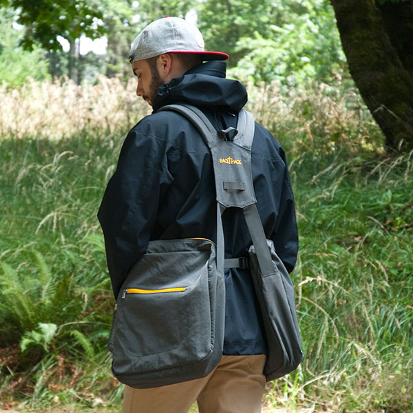 Photo from the back of a man wearing BackTpack 4 outdoors