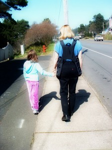 Mother and Child walking with BackTpack