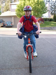Child on a bicycle with BackTpack