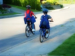 Children cycling with BackTpack