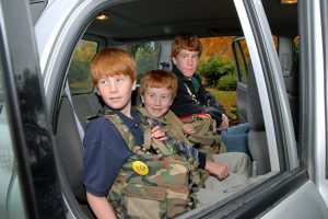 Three brothers in the back seat with their BackTpacks on, no problem