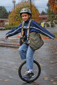 Child Using BackTpack on a unicycle