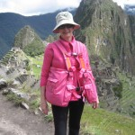Woman in Peru comfortably wearing her bright pink BackTpack