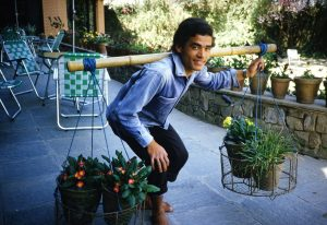 Gardener in Nepal using bilateral carrying system, straight back and excellent body mechanics