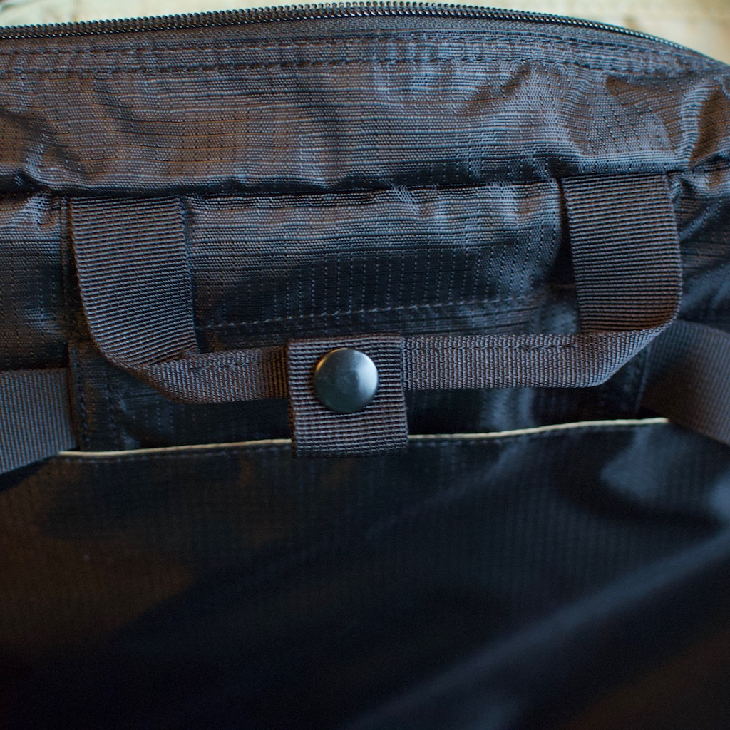 Detail photo of BackTpack 3.1 black briefcase handle which is one each side with snap closure