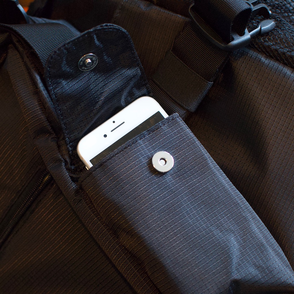 Detail photo of BackTpack 3.1 black cellphone pocket with cellphone within it