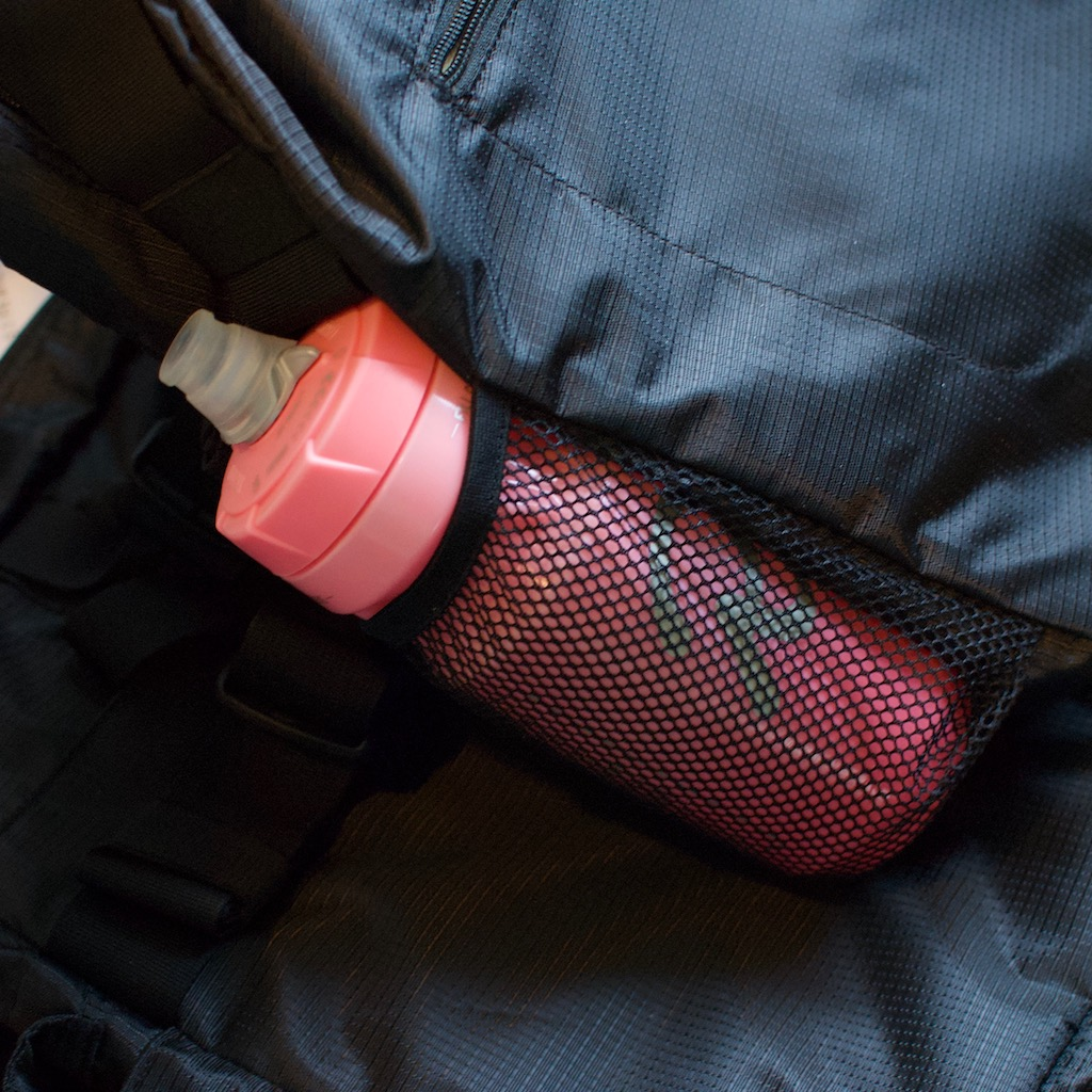 Detail photo of BackTpack 3.1 black water bottle holder with water bottle inside