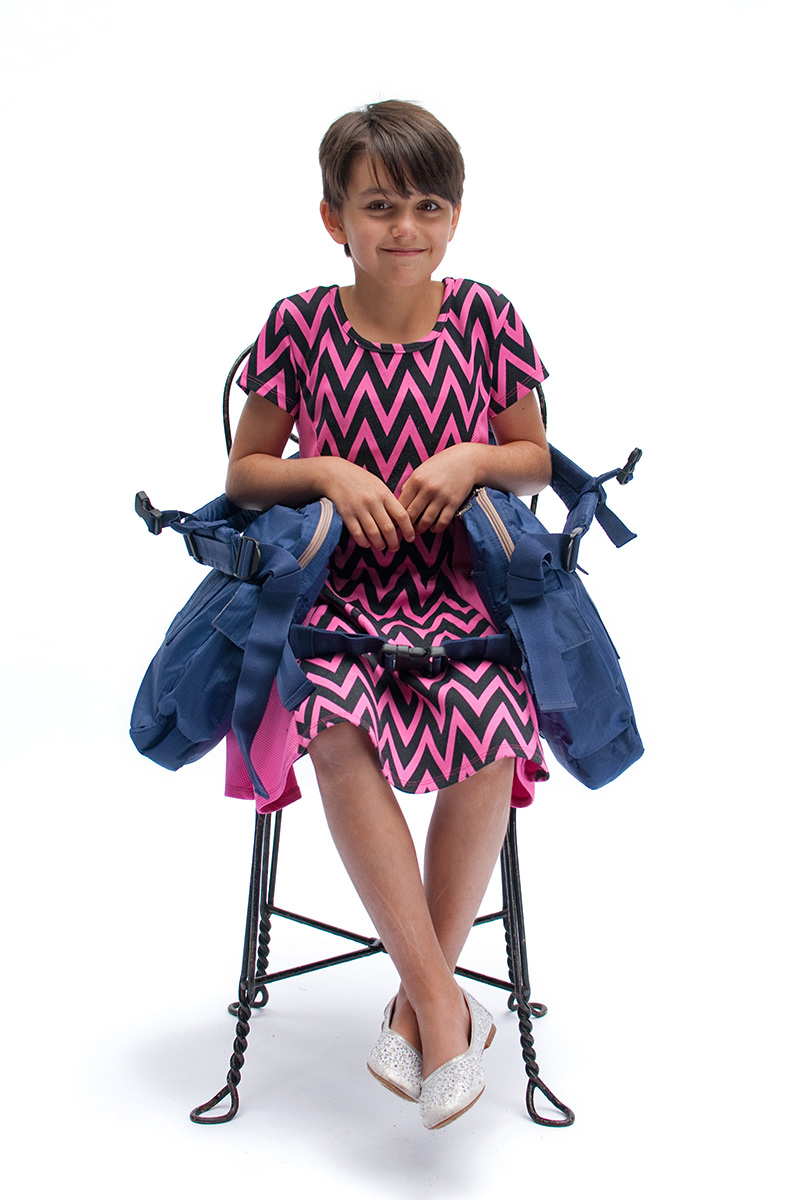 You can sit in an armless chair with BackTpack's Lap-Strap fastened and even remove your shoulder straps