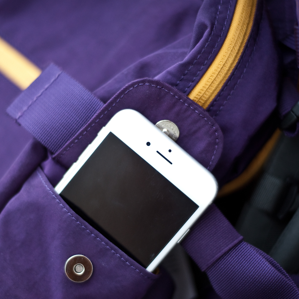 BackTpack 4 with cellphone in cellphone pocket showing magnetic snap closures