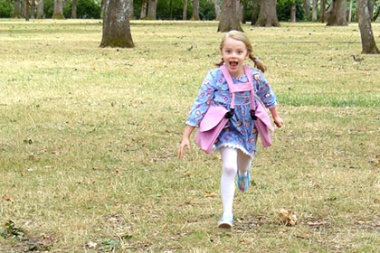 girl running with BackTpack Mini