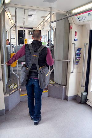Back view of BackTpack wearer entering a bus