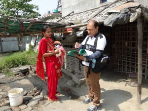Physician in Nepal using BackTpack as he assesses patients in villages