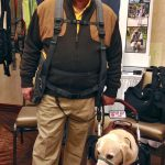Ed wearing BackTpack with Alepo his service dog