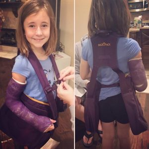 Little girl with scolioisis brace wearing BackTpack