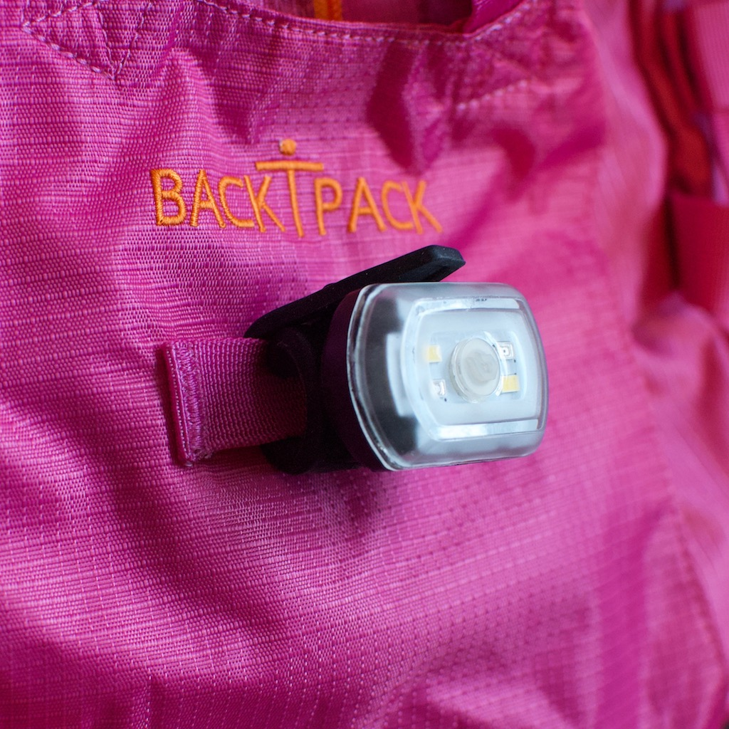 BackTpack 3.1 bike light attachment on back panel of BackTpack 3.1, magenta