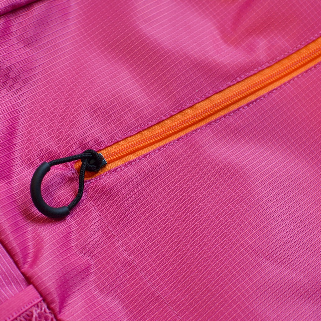 Detail photo of magenta BackTpack 3.1 orange zipper with black loop zipper pull