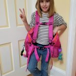 Ten year old girl happy with pink BackTpack 3.1